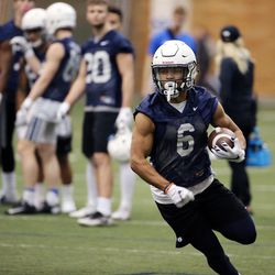 Trey Dye runs the ball during Brigham Young University football practice in Provo on Monday, Feb. 27, 2017.