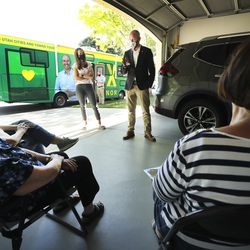 Abby Cox, left, and her husband, Lt. Gov. Spencer Cox, meet with a group in a garage in Midvale on Thursday June 11, 2020, as they campaign in the Utah gubernatorial race.