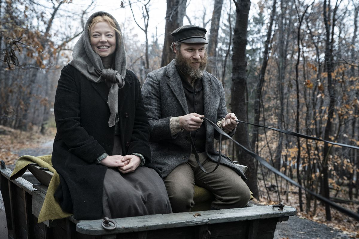 In a 1919 scene, Sarah Snook and Seth Rogen ride in a horse cart in American Pickle.