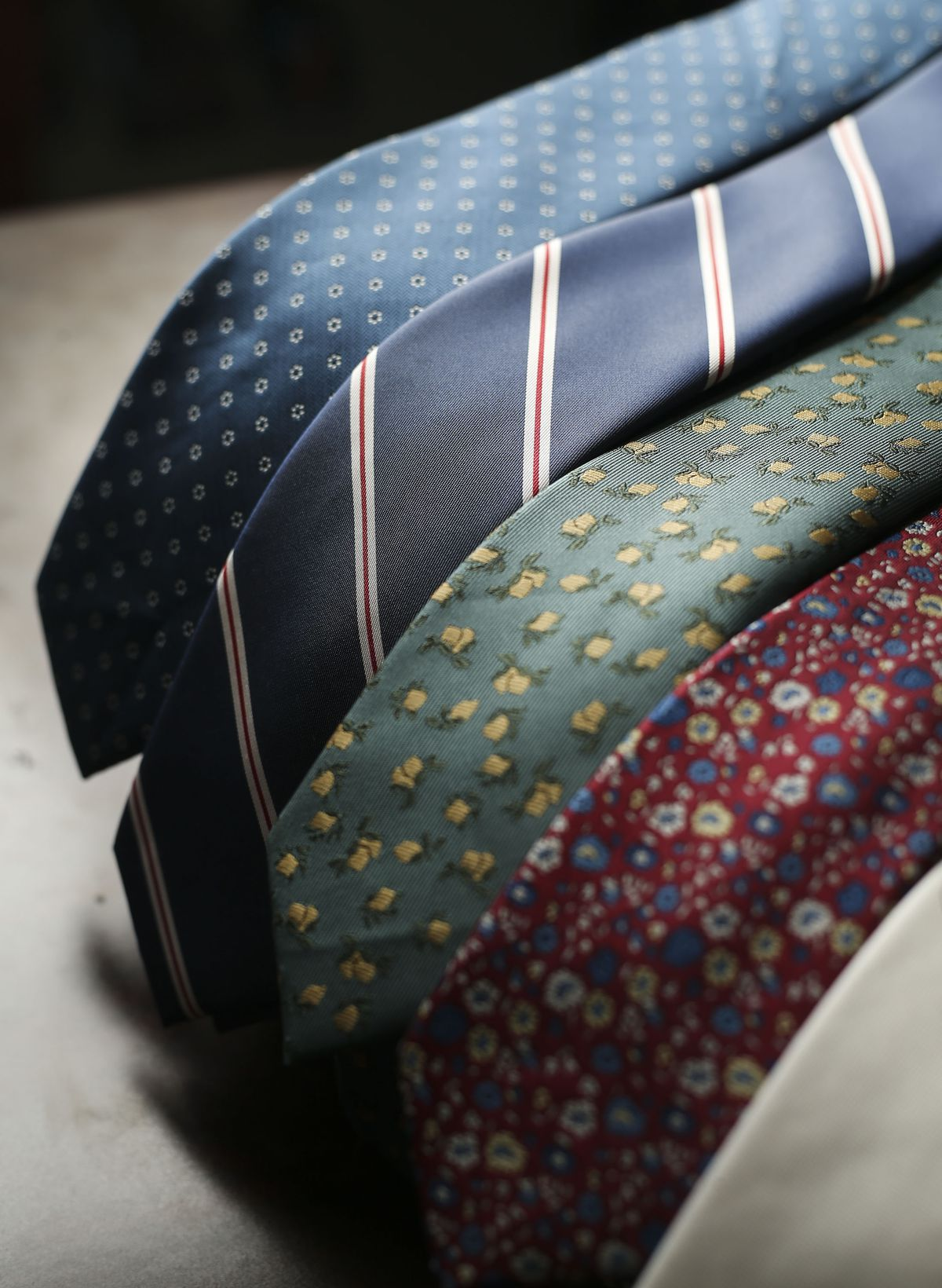 Men's ties that are made out of recycled plastic are displayed at &Collar in Salt Lake City on Thursday, April 8, 2021.