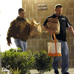George Zimmerman, left, walks out of the intake building at the John E. Polk Correctional Facility with an unidentified man on Sunday, April 22, 2012, in Sanford, Fla.  Zimmerman posted bail on a $150,000 bond on a second degree murder charge in the February shooting death of 17 year-old Trayvon Martin In Sanford, Fla.