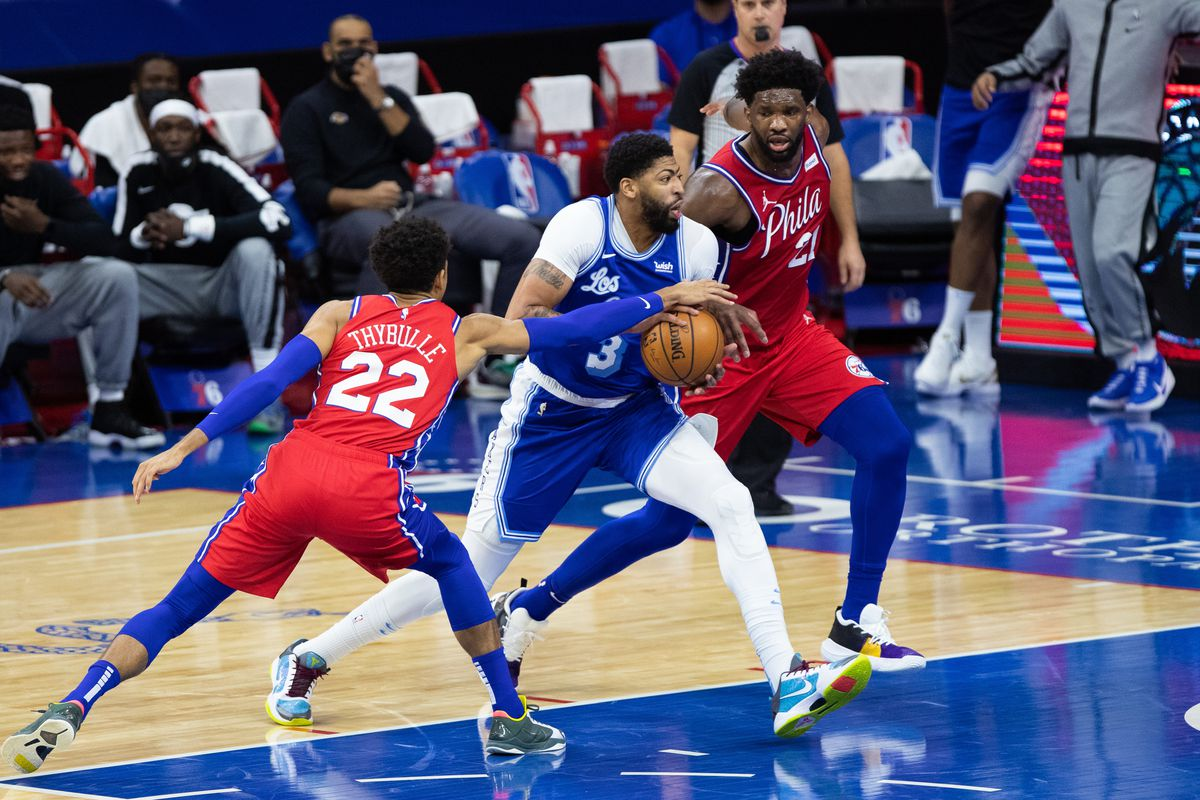 Los Angeles Lakers forward Anthony Davis (3) drives for a shot against Philadelphia 76ers center Joel Embiid (21) and guard Matisse Thybulle (22) during the second quarter at Wells Fargo Center.