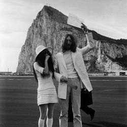 Yoko Ono kept a traditional color scheme for her March 20th,1969 wedding with John Lennon, but the full look — a miniskirt, knee socks, and wide-brim hat — was true to her highly individualized style.