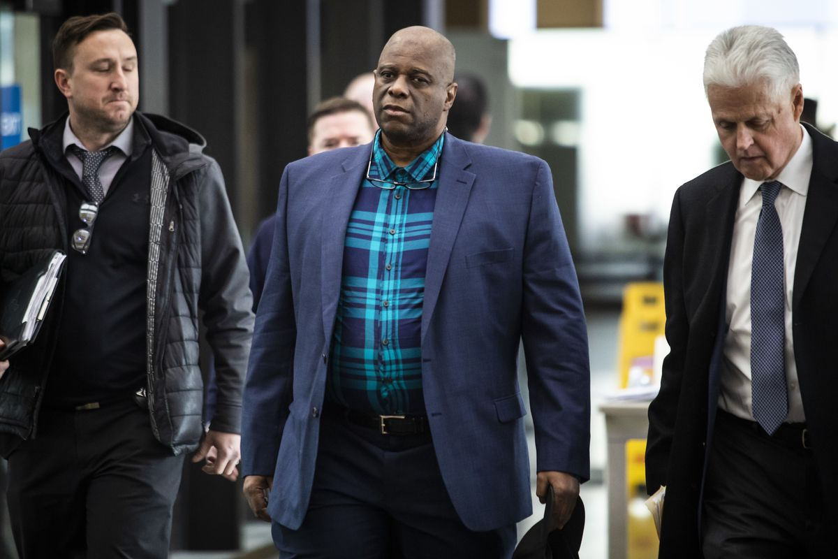 Chicago Police Officer Lowell Houser, charged with murder for shooting and killing an unarmed man during an off-duty argument in 2017, walks into the Leighton Criminal Courthouse, Friday morning, Dec. 20, 2019.