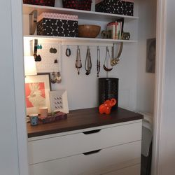 The Ikea Home Tour Squad turned an awkward, shallow closet into more usable storage space. The closet unit is a mashup of PRAGEL countertop and STOLMEN drawer units.