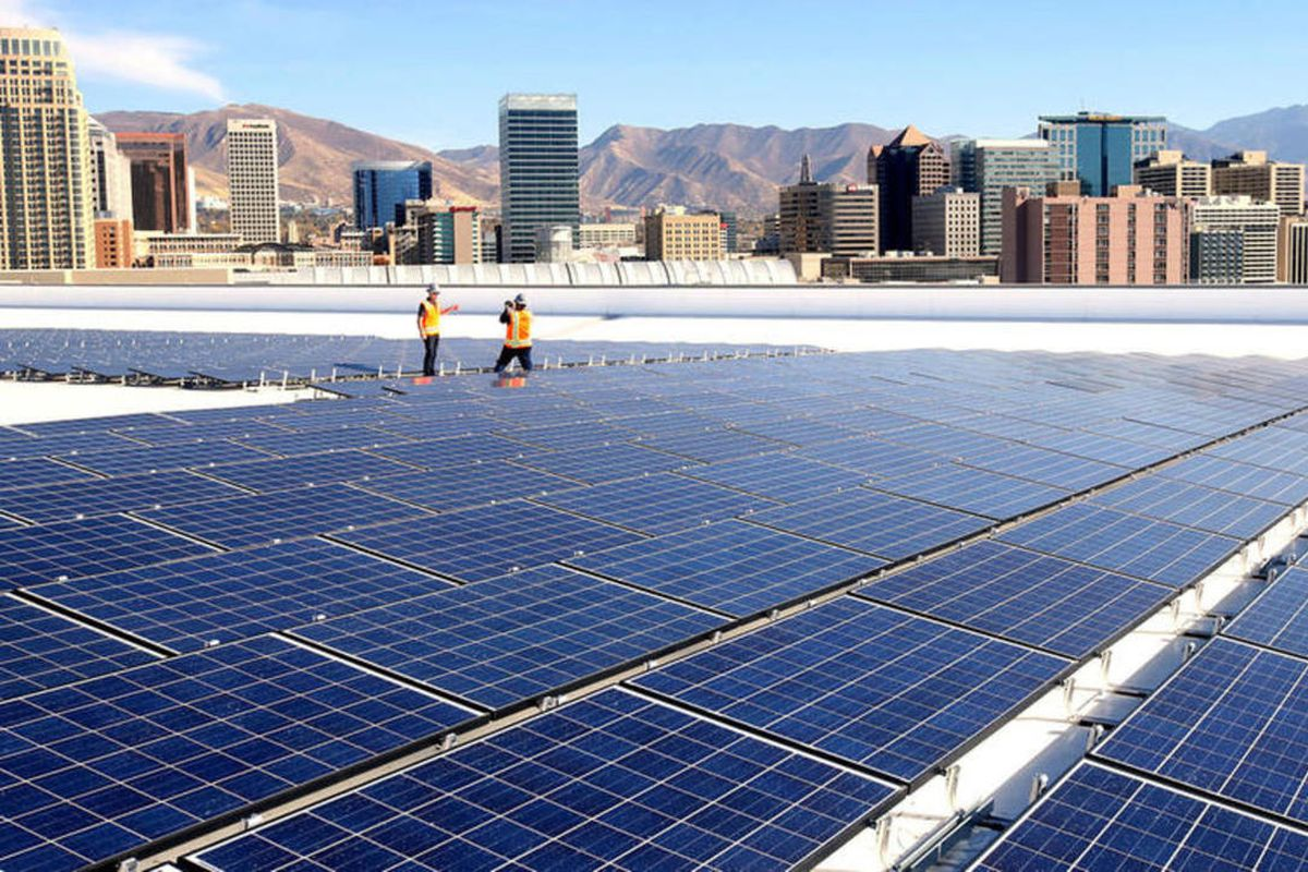 FILE: Scott Thompson and Ed Tallerico of BOMA Utah (Building Owners and Managers Association of Utah) take photos of each other during a tour of the new rooftop solar installation at Vivint Smart Home Arena in Salt Lake City on Wednesday, Oct. 26, 2016. A