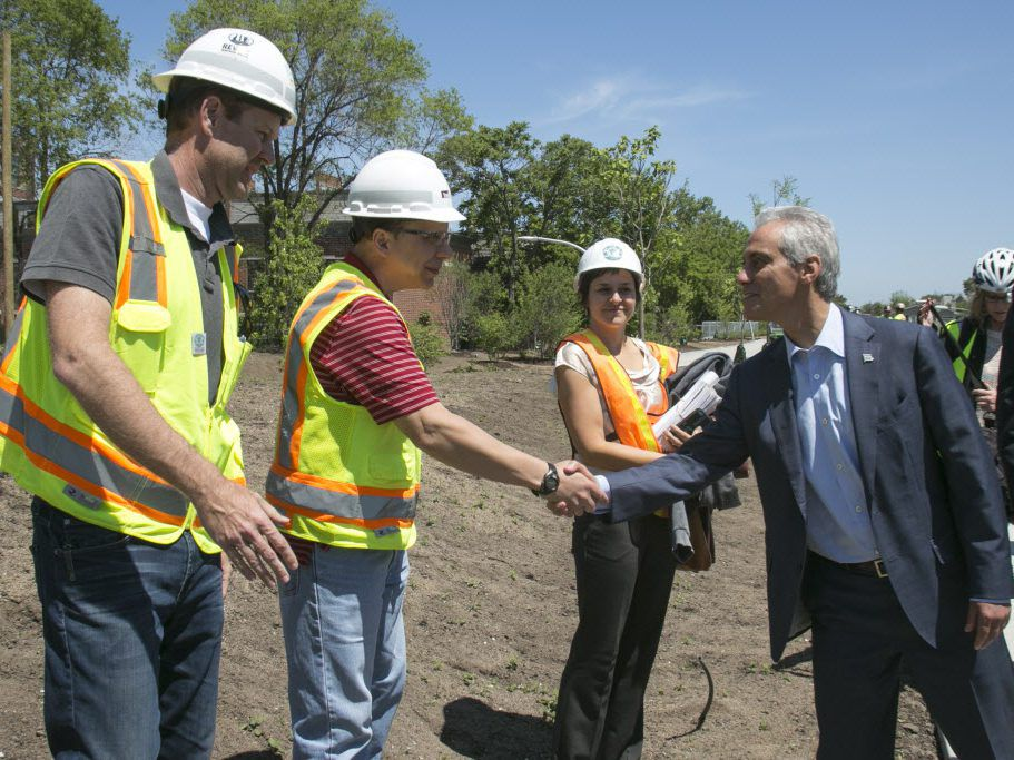 Mayor Rahm Emanuel greeted construction workers as he took a tour of The 606 Trail, which opened in 2015. | Ashlee Rezin/Sun-Times