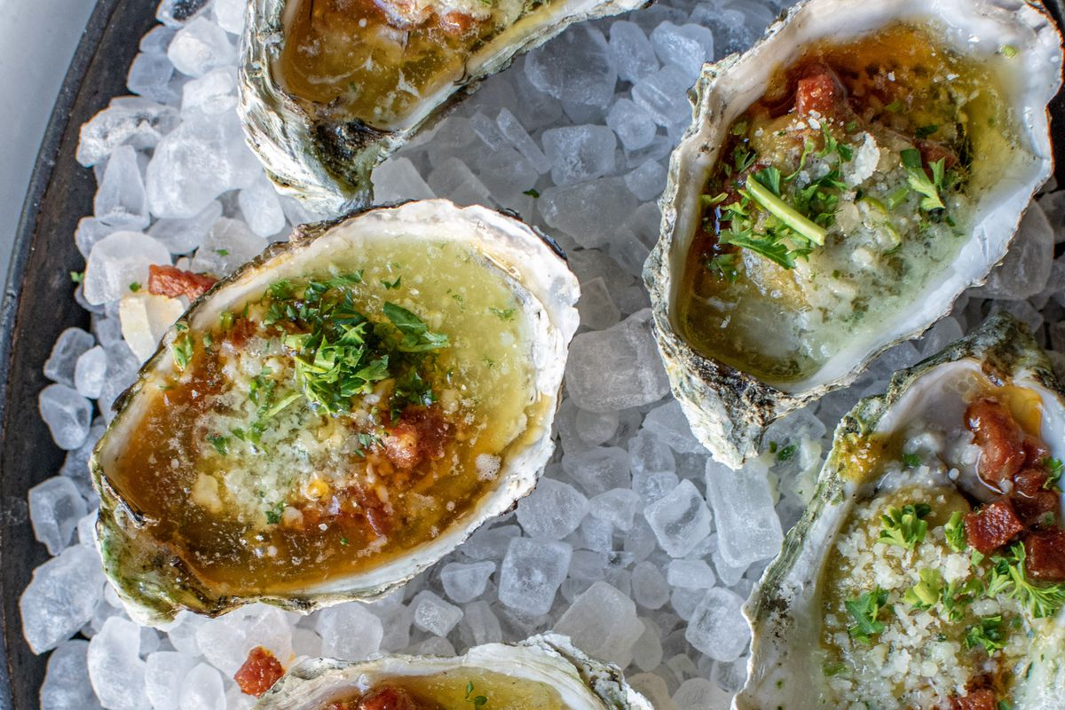 Roasted Oysters with salsa verde, pork longaniza and parmesan butter