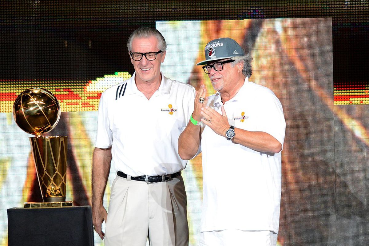 June 25, 2012; Miami, FL, USA; Miami Heat president Pat Riley (left) and Heat owner Micky Arison (right) celebrate the 2012 NBA championship during a rally at American Airlines Arena. Mandatory Credit: Steve Mitchell-US PRESSWIRE