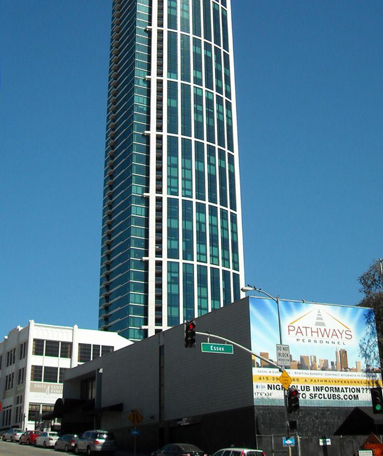 A tall building amongst shorter buildings.