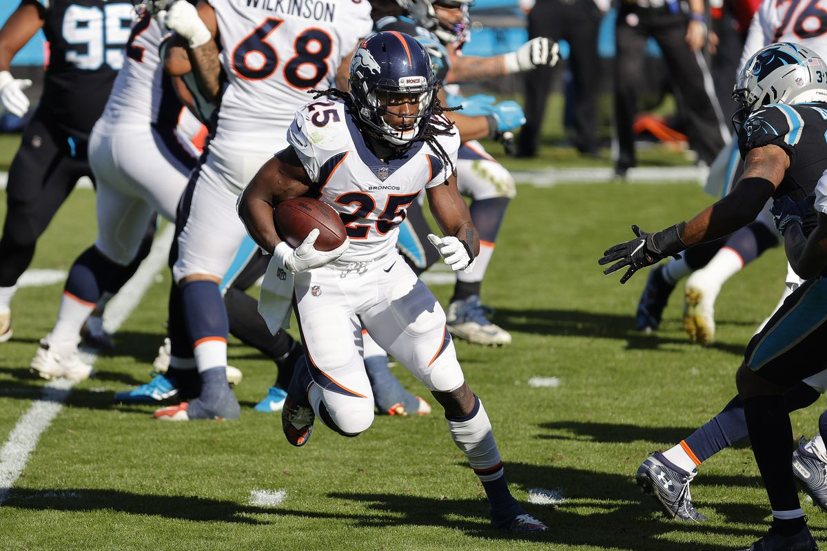 Melvin Gordon III #25 of the Denver Broncos runs the ball against the Carolina Panthers during the first quarter at Bank of America Stadium on December 13, 2020 in Charlotte, North Carolina.