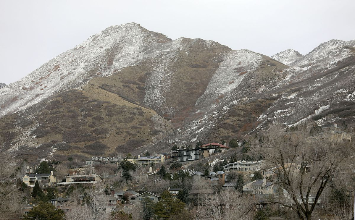 Snow dusts the foothills above Salt Lake City on Tuesday, Feb. 9, 2021. With a shallow snowpack, water runoff is expected to be less than normal this year.