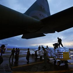Food and supplies are unloaded from a military transport plane in Tacloban, Wednesday, Nov. 20, 2013, following Typhoon Haiyan in the Philippines. Passengers were later loaded and allowed to ride to Cebu.