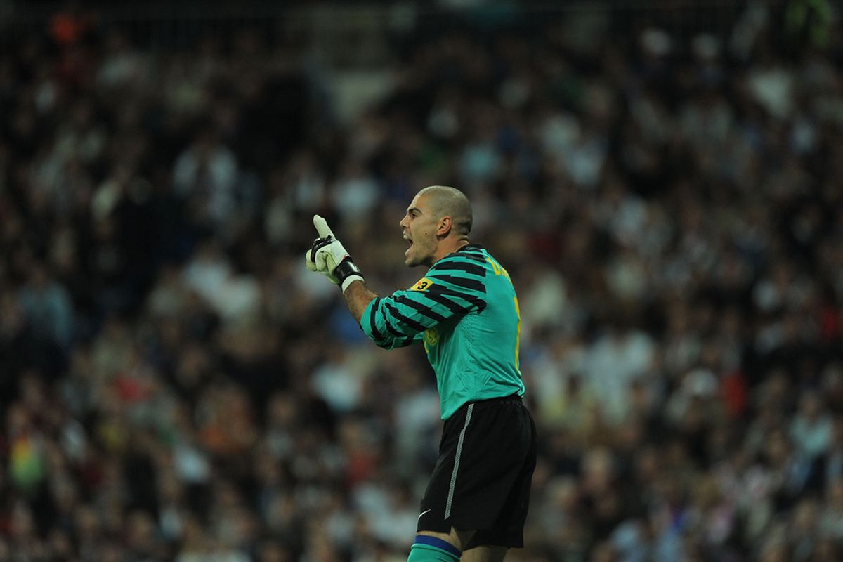 MADRID, SPAIN - APRIL 16: Victor Valdes of Barcelona reacts during the La Liga match between Real Madrid and Barcelona at Estadio Santiago Bernabeu on April 16, 2011 in Madrid, Spain.  (Photo by Denis Doyle/Getty Images)