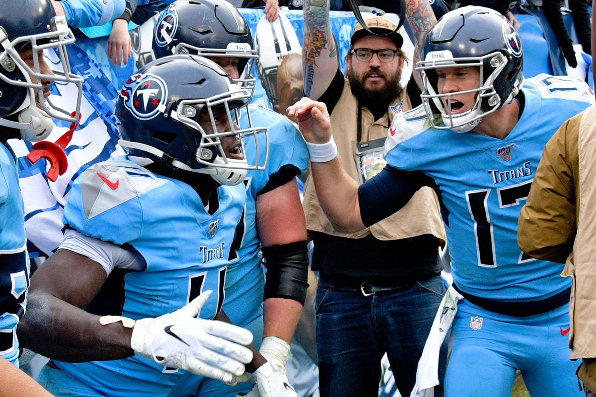 Tennessee Titans quarterback Ryan Tannehill congratulates Titans wide receiver A.J. Brown for scoring a touchdown against the Houston Texans during the second half at Nissan Stadium.