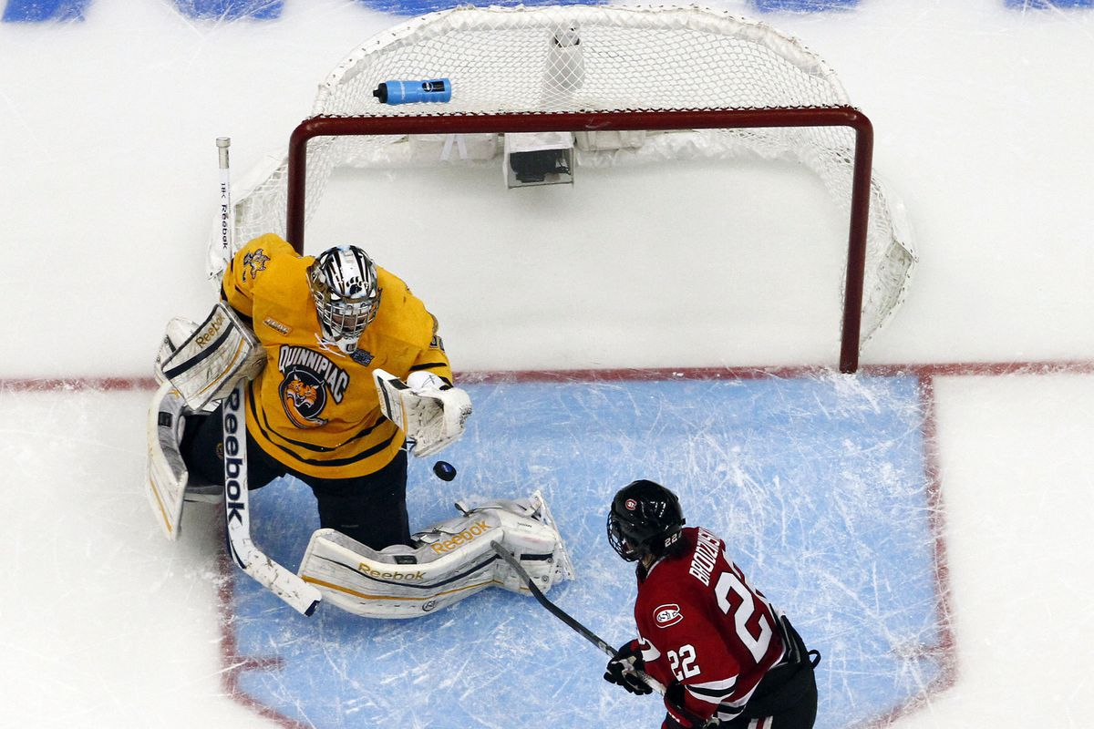 Quinnipiac goaltender Eric Hartzell makes a save in the Frozen Four.