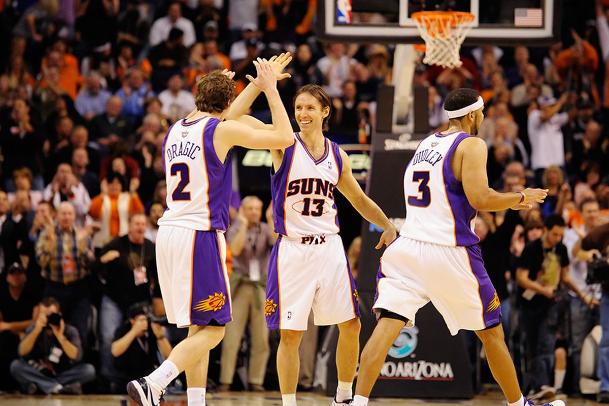 The Phoenix Suns celebrate a big win over the San Antonio Spurs. The Suns are undefeated at home this season. (Photo by Max Simbron)