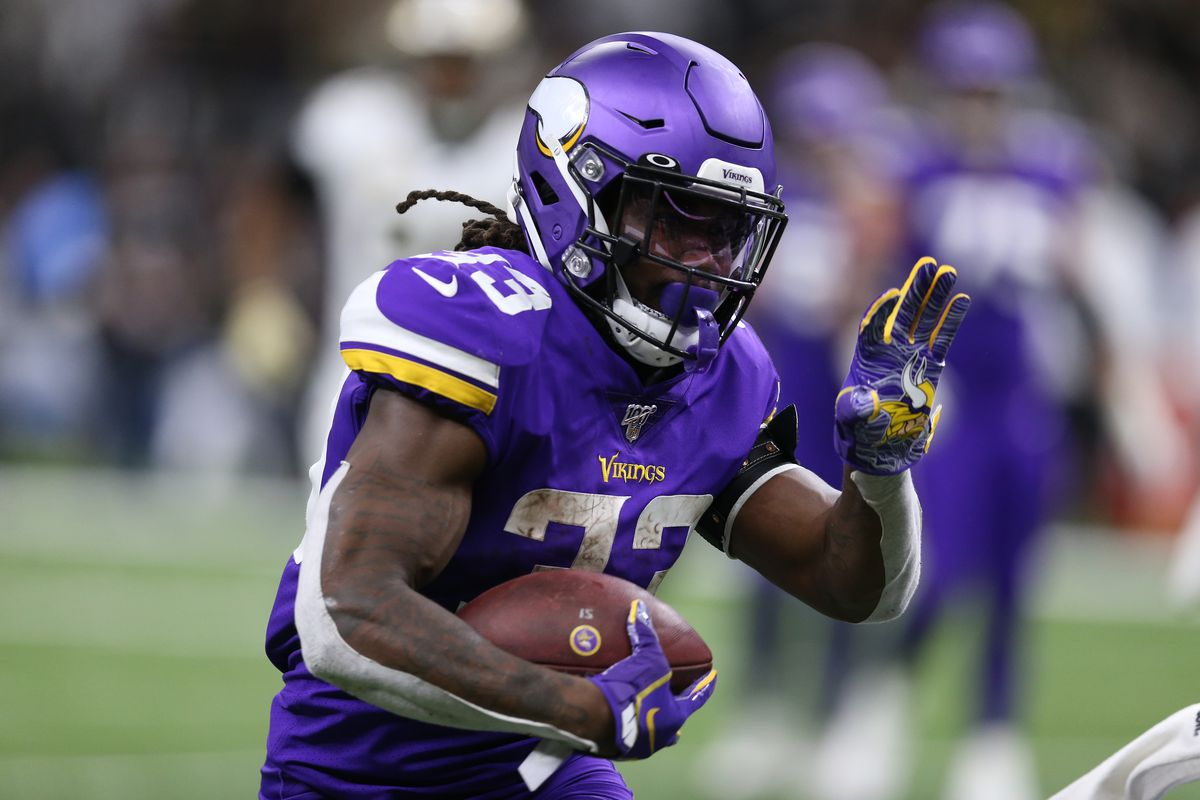 Minnesota Vikings running back Dalvin Cook runs the ball against the New Orleans Saints during the second quarter of a NFC Wild Card playoff football game.