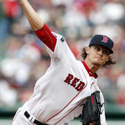 Boston Red Sox's Clay Buchholz pitches in the first inning of a baseball game against the Tampa Bay Rays in Boston, Saturday, April 14, 2012.