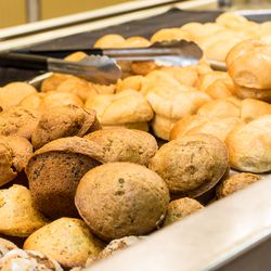 Fresh-baked muffins and rolls.