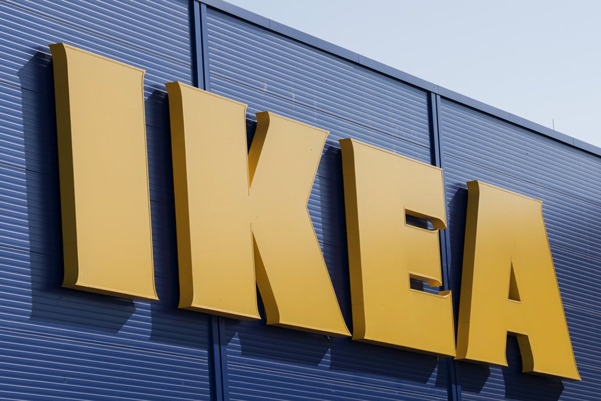 The IKEA sign on the outside of a furniture store.