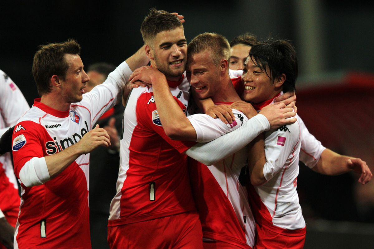 Players for FC Utrecht celebrate a goal during a 2012 Eredivisie match. Midfielder Gianluca Nijholt may be joining the Men in Red, according to his agent.