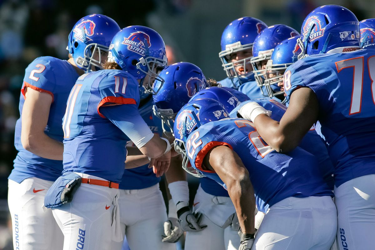 BOISE, ID - NOVEMBER 26: Kellen Moore #11 of the Boise State Broncos calls a play against the Wyoming Cowboys at Bronco Stadium on November 26, 2011 in Boise, Idaho.  (Photo by Otto Kitsinger III/Getty Images)
