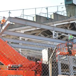 Another beam being positioned in the right-center field patio -