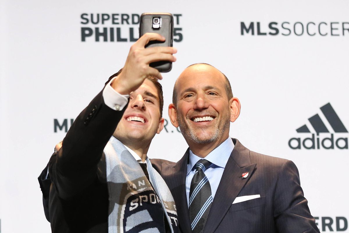 Connor takes selfie with Don Garber