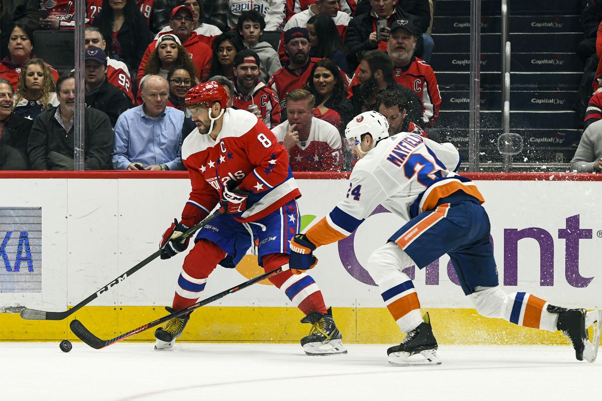 Washington Capitals left wing Alex Ovechkin looks to pass against New York Islanders defenseman Scott Mayfield in the second period on February 10, 2020 at the Capital One Arena in Washington, D.C.