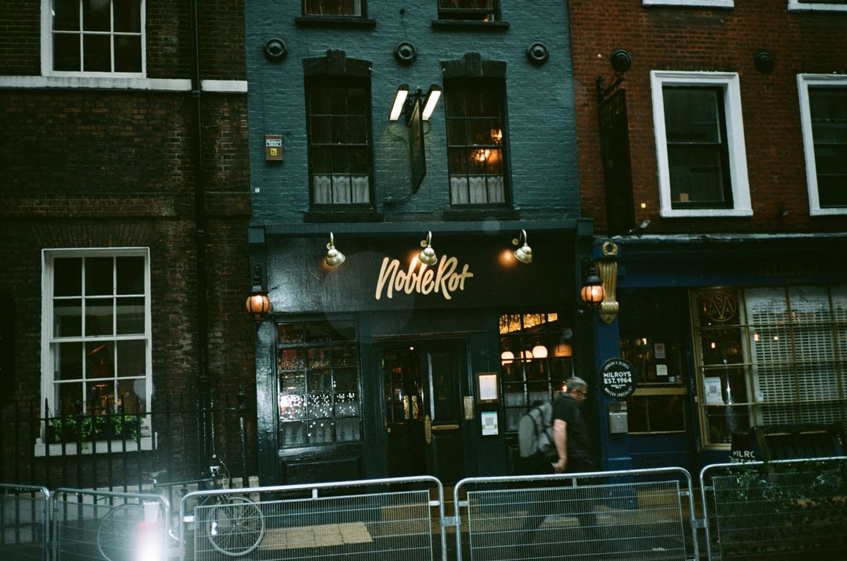 Noble Rot Soho on Monday night, with fencing erected outside it