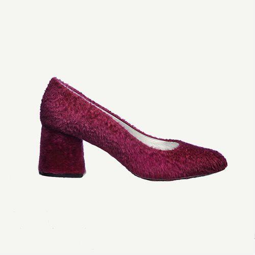 Magenta shearling block heels.