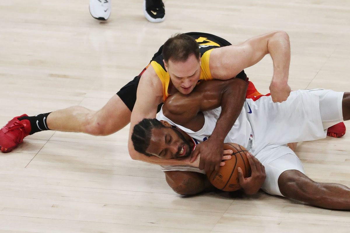Utah Jazz's Bojan Bogdanovic and LA Clippers' Kawhi Leonard fight for the ball during Game 2 of their playoff series in SLC.