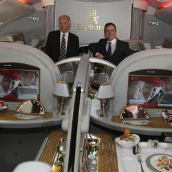 Qantas CEO Alan Joyce, right, and Emirates President Tim Clark pose for photos in the first class cabin of an A-380 Emirates aircraft after announcing a global aviation partnership in Sydney, Australia, Thursday, Sept. 6, 2012. Qantas Airways Ltd. announced Thursday that it has signed a 10-year partnership deal with rival Emirates in a bid to boost the Australian airline's struggling international division. The deal is subject to regulatory approval.