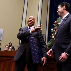 Rep. Elijah E. Cummings, D-Md, and Rep. Jason Chaffetz, R-Utah, joke during their staff's holiday party at the U.S. Capitol in Washington, D.C., on Tuesday, Dec. 8, 2015. Cummings and Chaffetz are members of the Oversight and Government Reform Committee.
