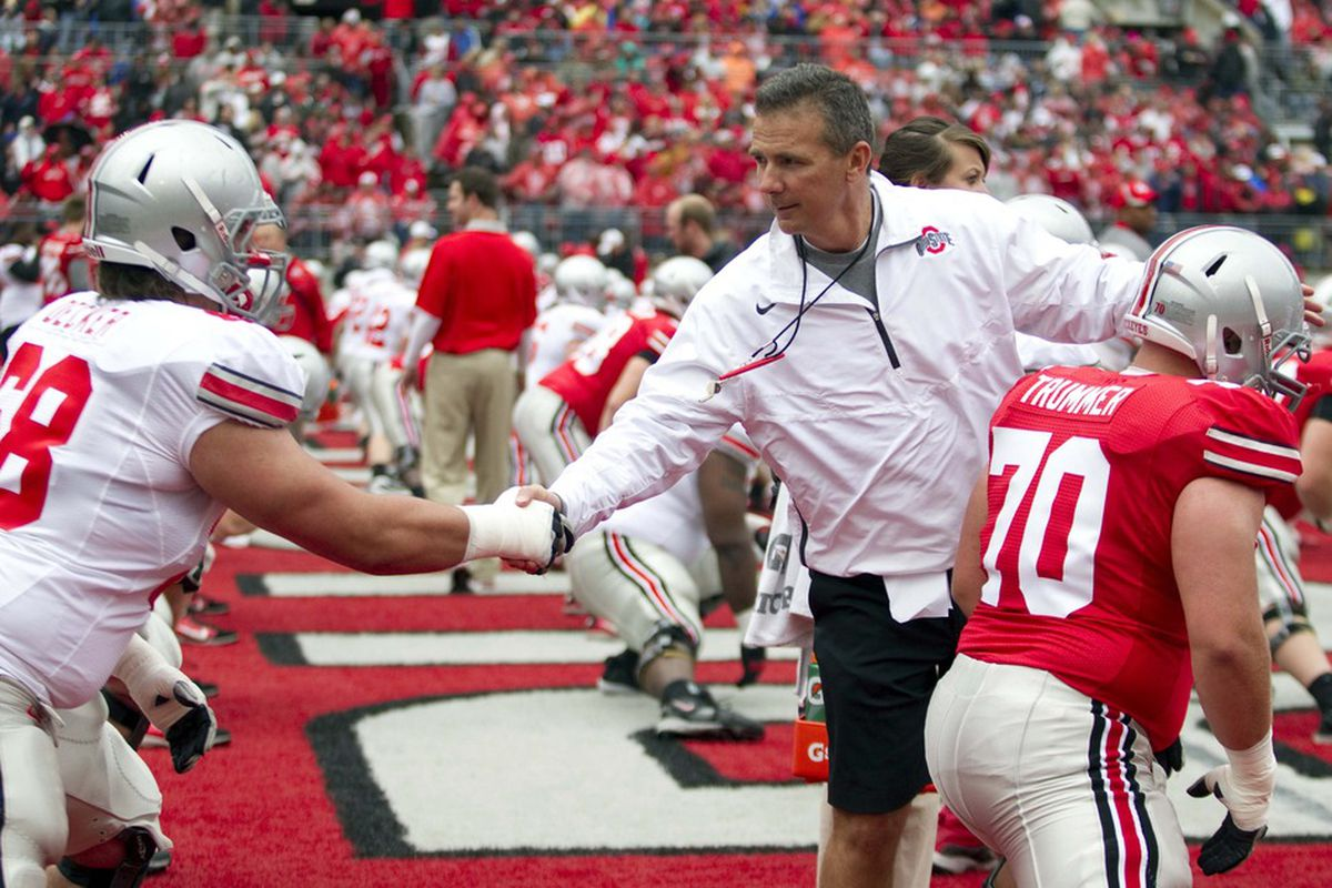 Urban Meyer shakes the hand of one of his prized pupils, the class of 2012's Taylor Decker.