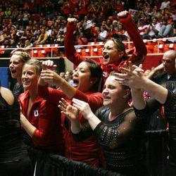 Utah cheers during the bars exercise at the NCAA Salt Lake Regional Gymnastics Saturday, April 7, 2012 in Salt Lake City.