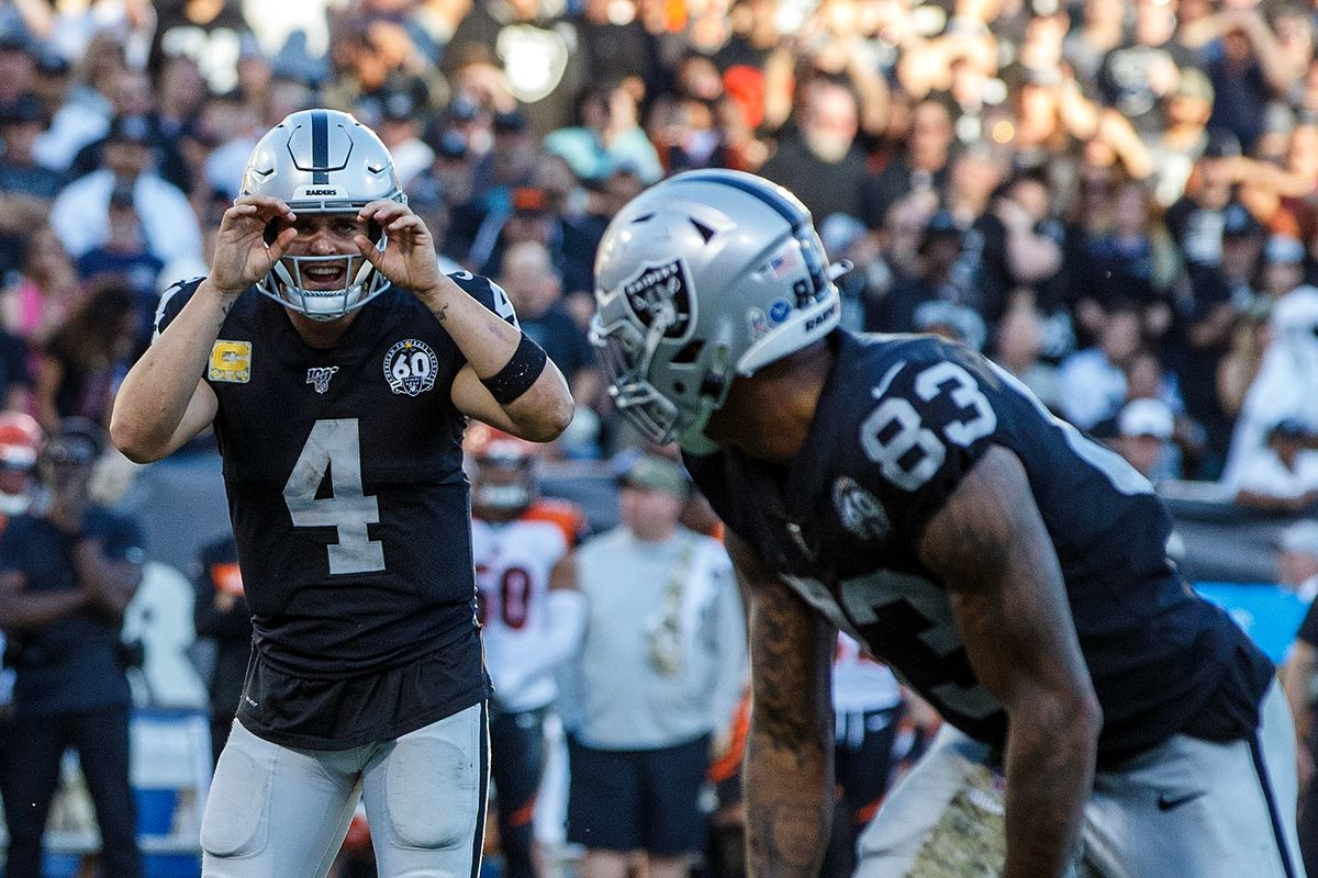 Quarterback Derek Carr #4 of the Oakland Raiders signals to tight end Darren Waller #83 during the fourth quarter against the Cincinnati Bengals at RingCentral Coliseum on November 17, 2019 in Oakland, California. The Oakland Raiders defeated the Cincinnati Bengals 17-10.