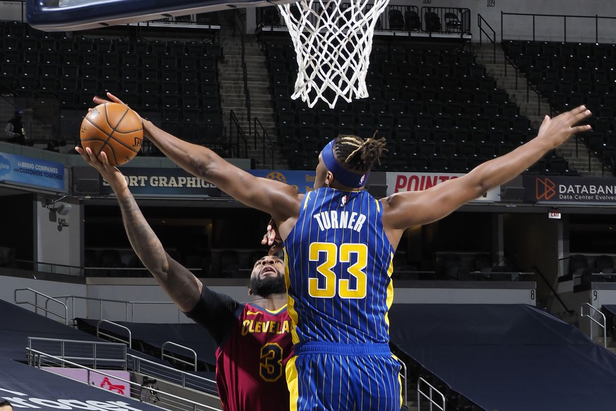 Myles Turner of the Indiana Pacers plays defense during the game against the Cleveland Cavaliers on December 31, 2020 at Bankers Life Fieldhouse in Indianapolis, Indiana.