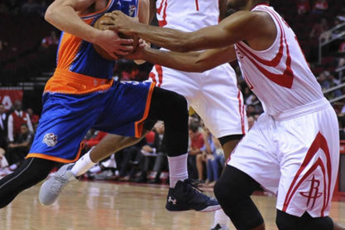 The Shanghai Sharks Jimmer Fredette, left, is defended by the Houston Rockets Eric Gordon (10)  in the first half of an NBA basketball exhibition game Sunday, Oct. 2, 2016, in Houston.