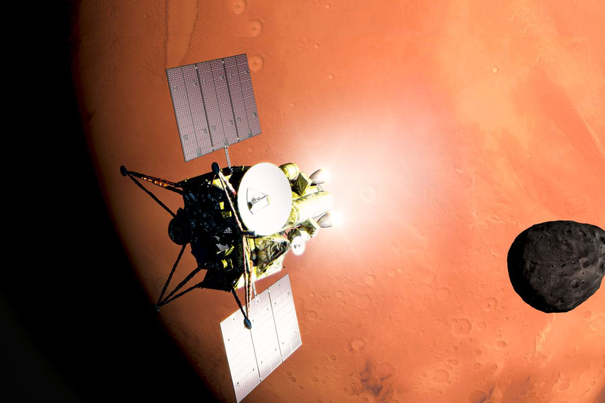 Spacecraft with satellite dish and two outstretched solar panels in front of Mars. A small moon, Phobos, is to the left.