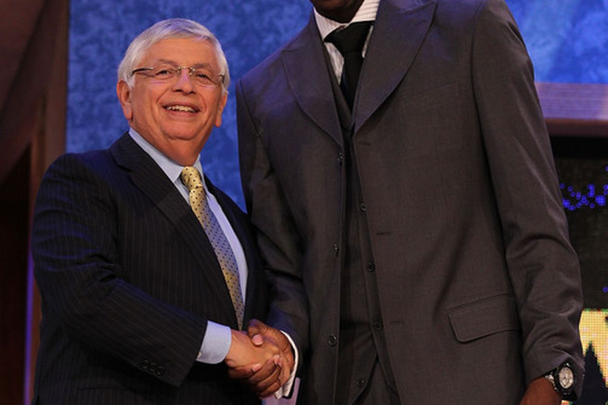 NEW YORK - JUNE 24:  Ekpe Udoh stands with NBA Commissioner David Stern after being drafted sixth by The Golden State warriors  at Madison Square Garden on June 24, 2010 in New York City.