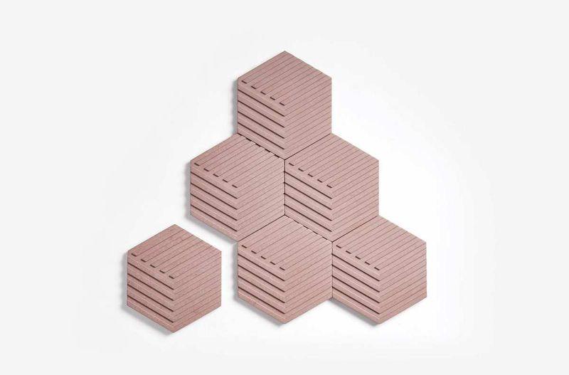 Hexagonal tiles in a blush color.
