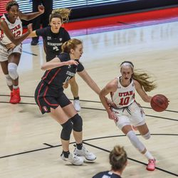 Utah Utes guard Dru Gylten (10) moves with the ball during a Pac-12 women's basketball game against the Stanford Cardinal at the Huntsman Center in Salt Lake City on Friday, Jan. 15, 2021.