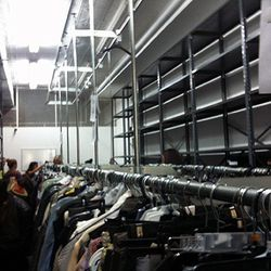 The Warehouse Sale is held in an actual warehouse space.