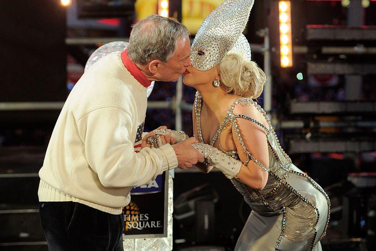 Mayor Bloomberg kisses Lady Gaga on New Year's Eve. Image via Getty