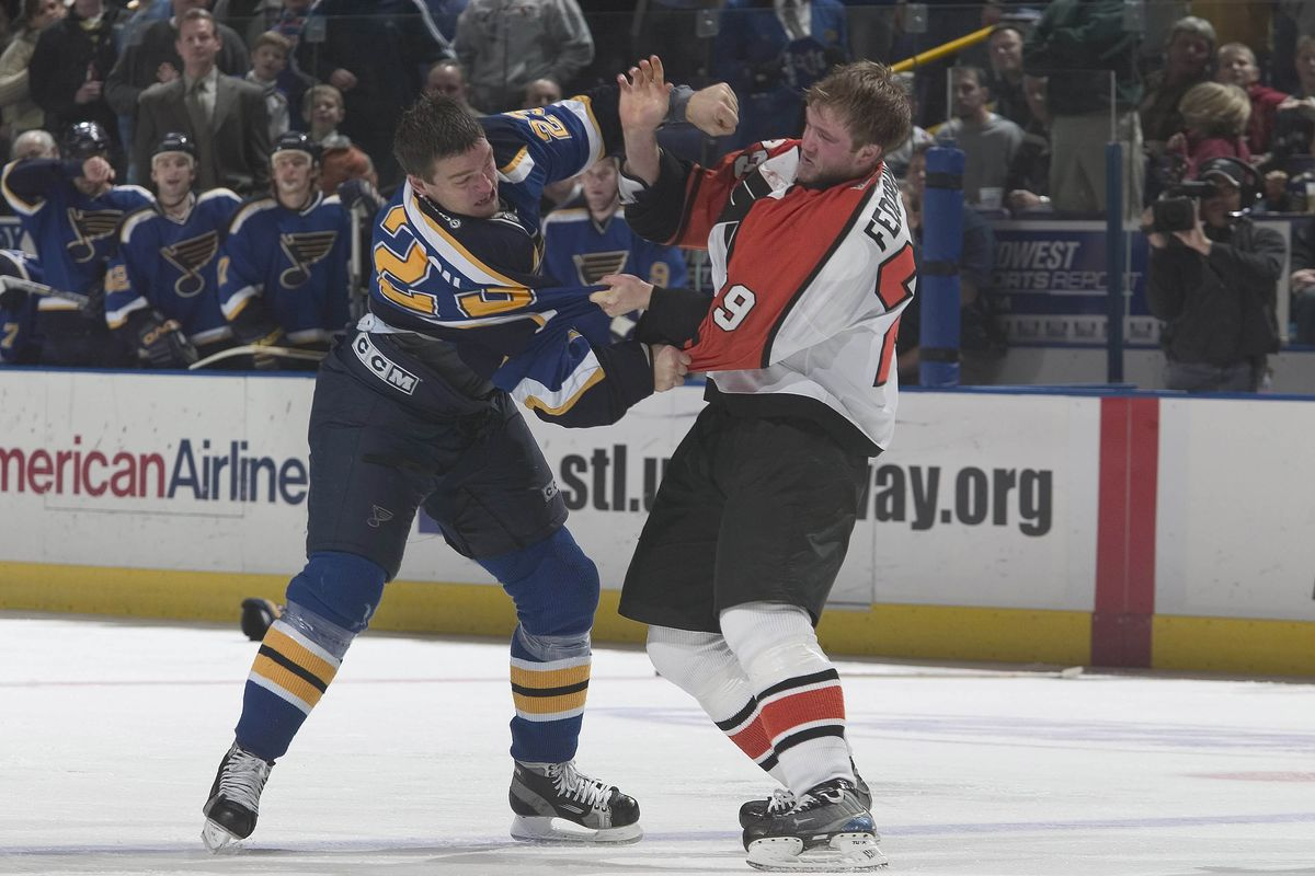 20 Dec 2003: Todd Fedoruk of the Philadelphia Flyers and the Murray Baron of the Blues fight during the Flyers 7-2 victory over the St. Louis Blues at the Savvis Center in St. Louis, MO.