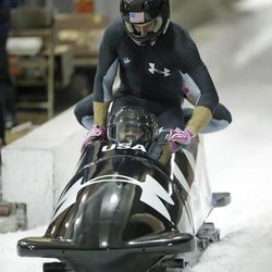 From front to back, Steve Holcomb and Curt Tomasevicz come to a stop after racing in the United States four-man bobsled team trials Saturday, Oct. 26, 2013, in Park City, Utah.  Holcomb nad his crew came in first place.  (AP Photo/Rick Bowmer)