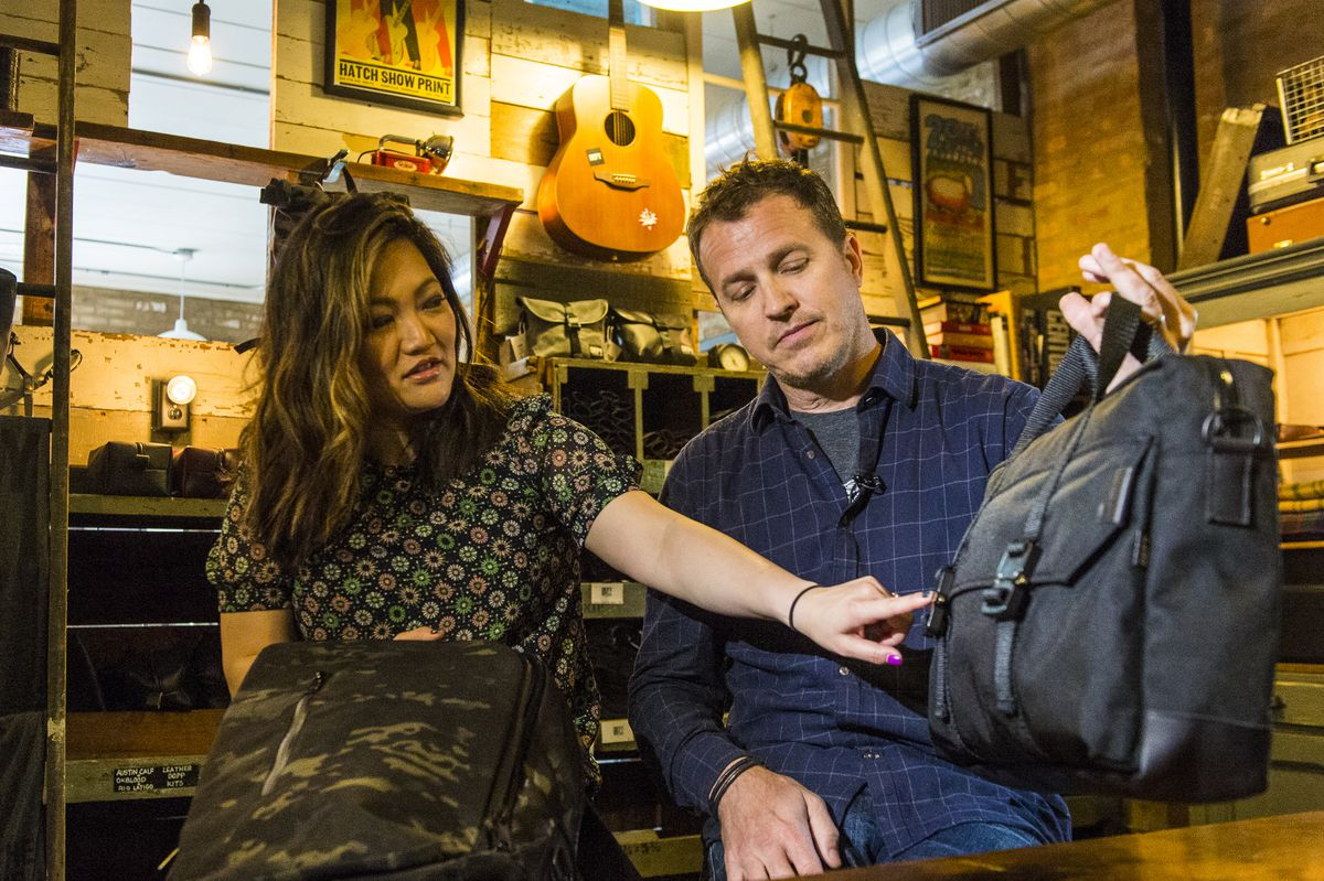 Ji Suk Yi with Chris Tag of Defy bags in Ravenswood.   Tyler LaRiviere/Sun-Times