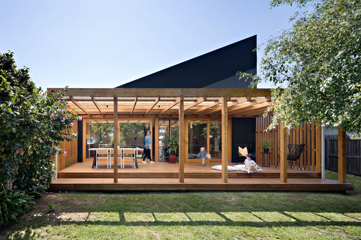 Angular modern addition extends this traditional cottage for Modern house additions